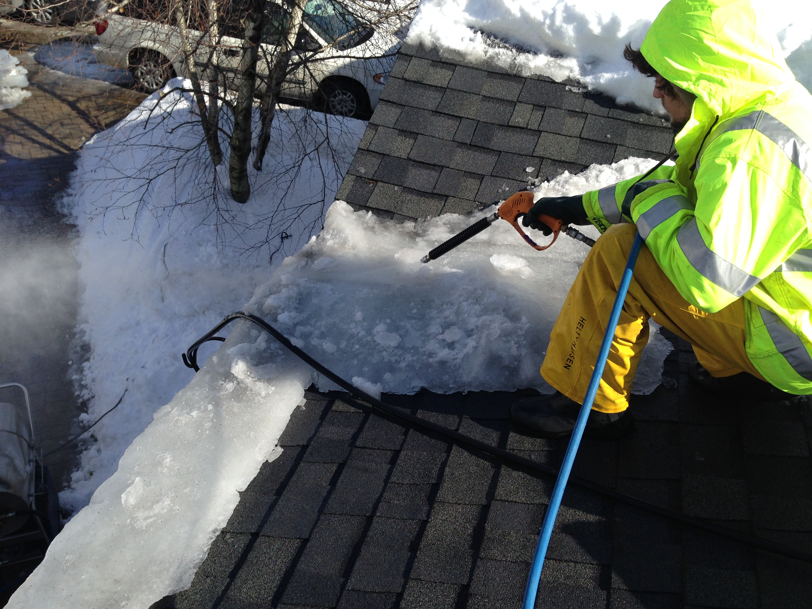 rtd on a roof using steam to remove the ice dam - call us 24 hours a day - roof to deck ice dam removal