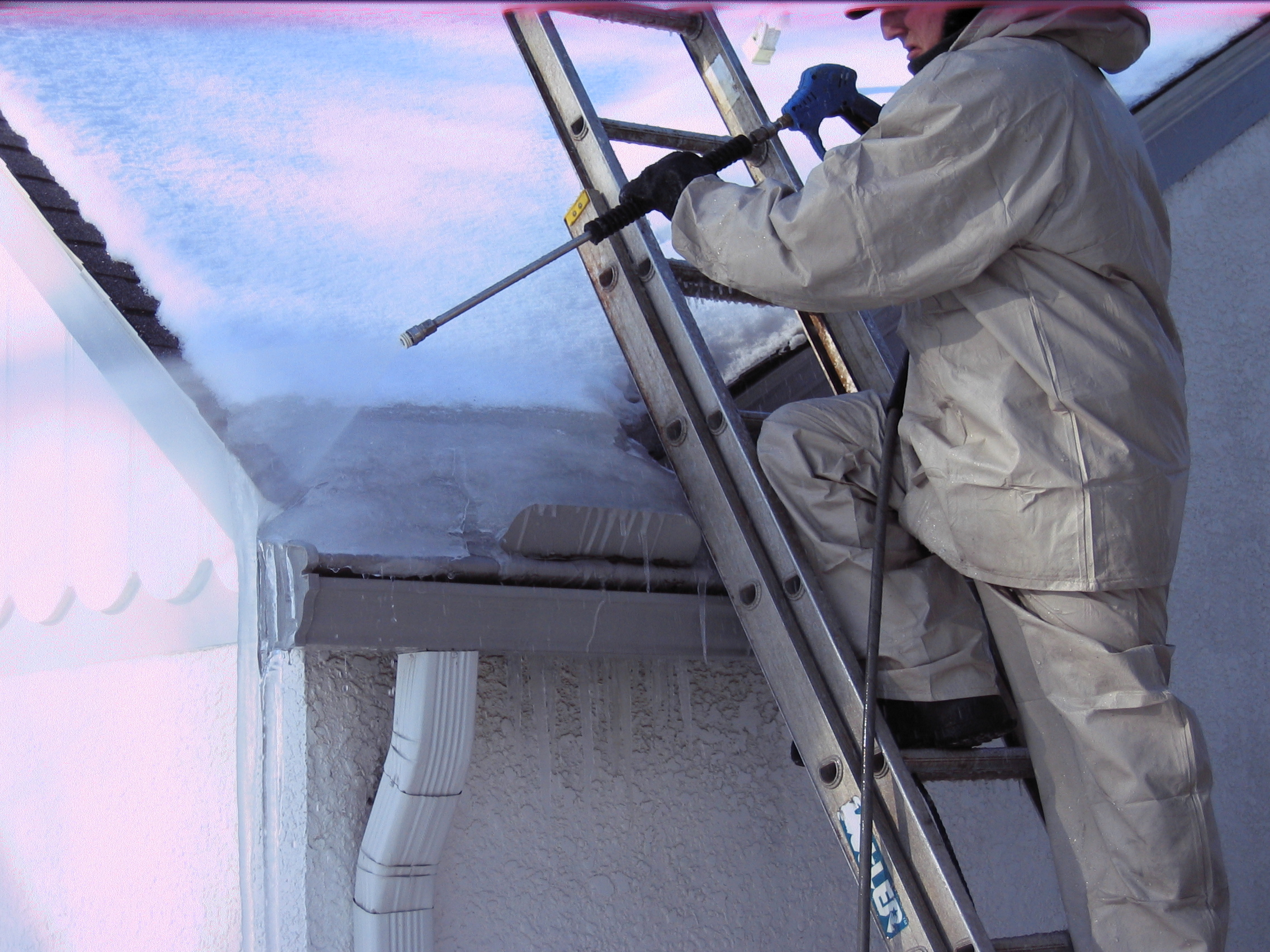 using steam to remove ice dam from a house - roof to deck ice dam removal